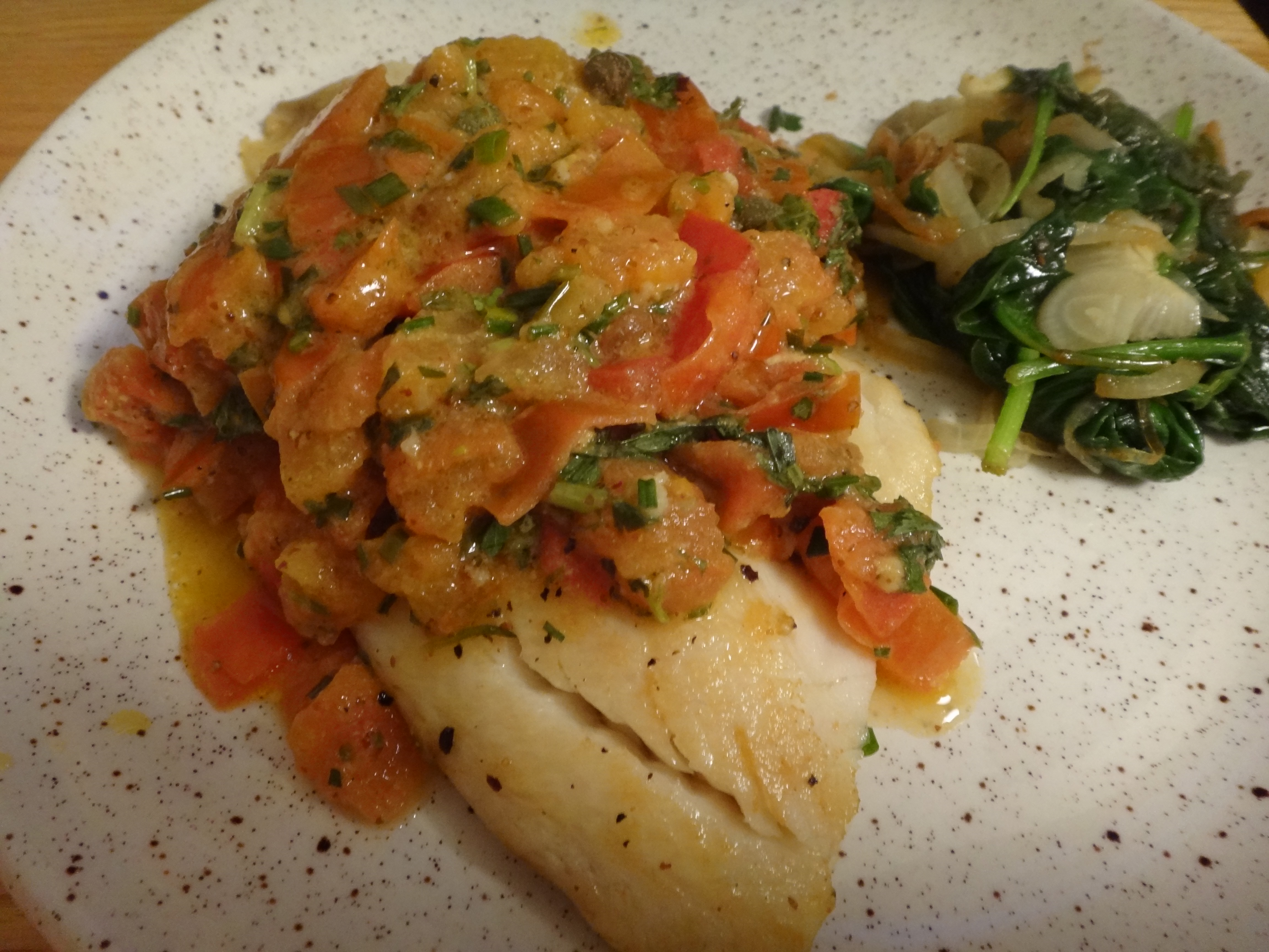 Pan fried fish fillets with mediterranean tomato sauce for Fried fish fillet recipes