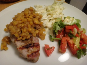 bolivian spiced grilled pork cutlets with split peas