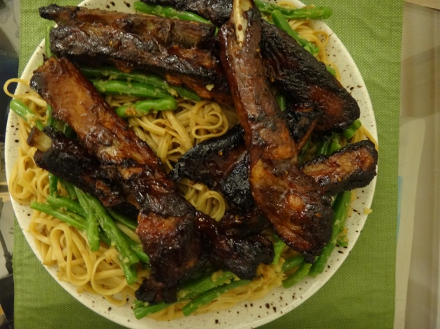 Chinese barbecued spare ribs with string beans in ginger and garlic on a bed of sesame noodles