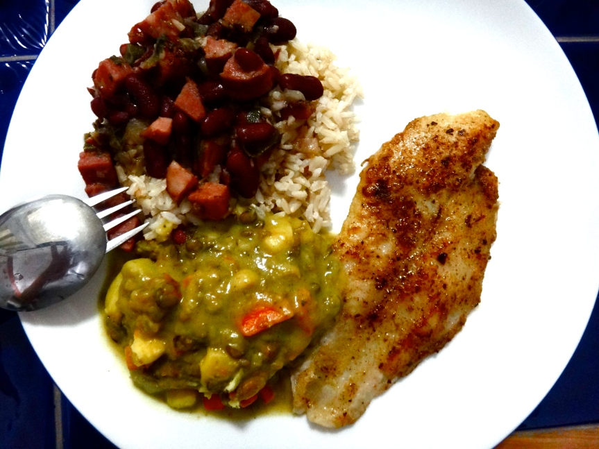 Whitefish with cajun seasoning, curried root vegetables, red beans and rice