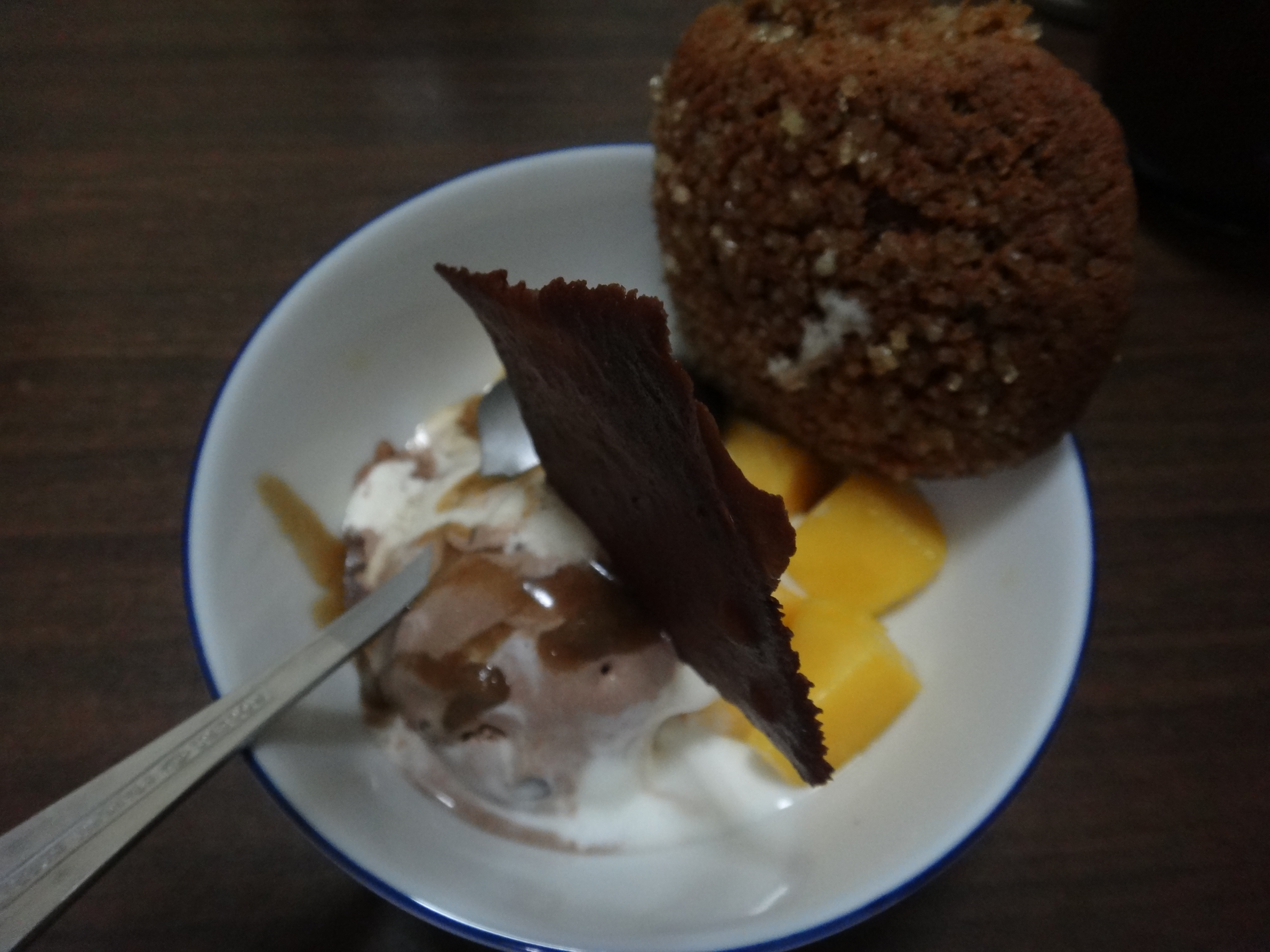 mango, ice cream, butterscotch sauce, ginger cookie and ...